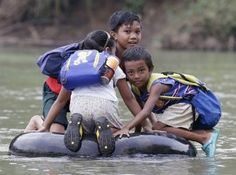 Kids getting to school across the world: Elementary School Students Crossing A River On Inflated Tire Tubes, Rizal Province, Philippines Schools Around The World, Kids Around The World, People Of The World, Around The Worlds, Walk To School, Public School, High School, Fotojournalismus, Thinking Day