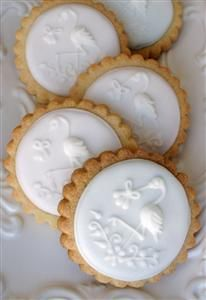 Stork Cookies by Montreal Confections (Press fondant into cookie press for icing plain cookies)