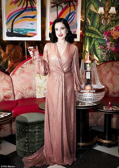 Pretty in pink: Dita Von Teese looked more glam than usual as she attended the Paul's Baby Grand Cocktail Lounge in New York City on Monday