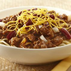 This authentic chili recipe gets its regional twist by adding cinnamon. Serve over spaghetti and top with kidney beans, Cheddar cheese and onions.