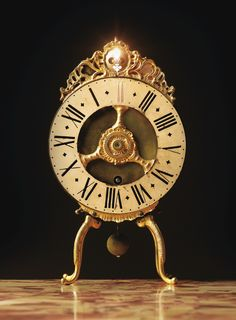 A GILT-BRONZE AND LACQUERED-BRONZE NIGHT CLOCK WITH A REVOLVING DIAL, BERNESE, SWISS, SIGNED IAC BLASER BERNE, CIRCA 1730