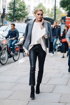 Olivia Palermo nails all of Fall 2017's items - blazer, detailed sleeves, kick hem leather pants and a classic bootie
