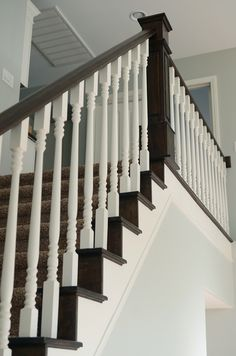 Nice house redo that's mostly  paint -- love especially the stair redo with walnut stain and new newel posts.