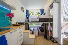 Kitchen, Living Room and Bedroom. 10 Square Meters Off Grid Shipping Container Tiny House. By Brenda Kelly.