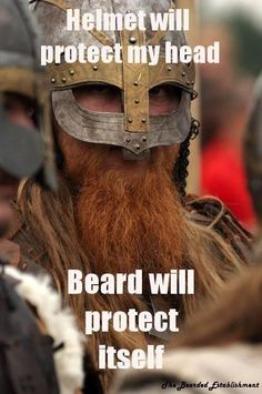 Funny Beard Quote: Helmet will protect my head. Beard will protect itself. - Color photo of a viking with a red beard.