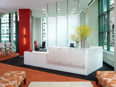 White reception station using Kimball Xsite panel system design@corporatedesigninteriors.com for more information