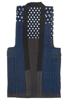An exceptional reversible indigo kasuri and stripe farmer's vest of handspun and woven cotton, finished inside and out. Early to mid 1900s.