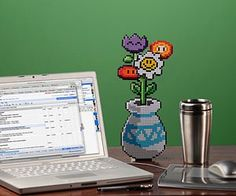 These pixelated flowers wont die when you forget to water them and are a great gift for your loved one. Its 13 inches tall, has 3 layers, includes a folding stand for display, and is super-cute and nerdy.