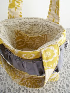 my knitting bag for the yellow parlor. it just needs some gorgeous grey silk yarn spilling out of it
