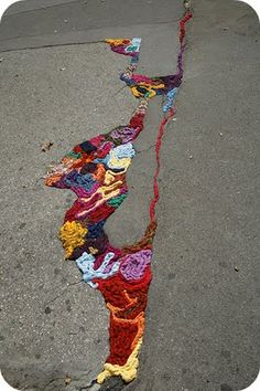 Yarn bomb cracks-- This looks like it would disappear in a matter of days, but its lovely.