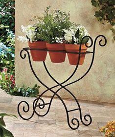 This Scrolled Iron Plant Cart is a sweet way to display 3 potted plants. Diy Garden Decor, Garden Art, Garden Design, Metal Plant Stand, Diy Plant Stand, Wrought Iron Decor, Iron Plant, Iron Furniture, Flower Stands