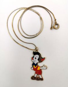 Pinocchio Vintage Metal Pendant Necklace Walt Disney Productions Cloisonne Style NEW old stock by VintageToysForAll on Etsy Kids Jewelry, Unique Jewelry, Modern Family Quotes, The Mindy Project, Star Cards, Necklace Chain Lengths, Little Twin Stars, Pinocchio, Vintage Metal