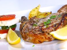 Greek Pork Chops Recipe with Roast Potatoes (Brizola sto Fourno) Delicious and super easy! Probably prefer the other recipe for potatoes I have that uses flour for crispiness Lemon Potatoes, Roasted Potatoes, Greek Feta Salad, Easter Dinner Recipes, Greek Dishes, Main Dishes, Greek Cooking, Crockpot, Chops Recipe