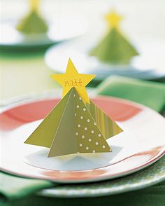Set your table for a holiday get-together with our homemade place cards, including paper-plate angels, evergreen place-card holders, and more.Plant a forest of place cards on the holiday kids' table.