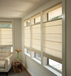 Silhouette blinds vs honeycomb shades modern window coverings shown in linen champagne solutioingenieria Images