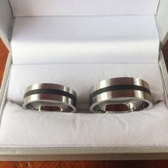 Stainless steel and ebony wood wedding rings