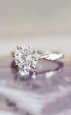 A unique twist on a simple solitaire engagement ring
