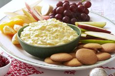 pineapple-lush-dip- Don't see how it can get any easier than this.  Stir pudding into can of pineapple and fold in carton of cool whip.  Nice dip that diabetics will like for dessert.