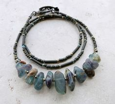This rustic, earthy, blue stone necklace is the perfect way to add a little extra character to your daily life. I created it using tumbled blue fluorite pebbles as the focus. As shown in the photos, t