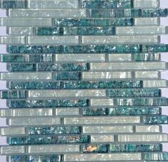Pearl Glass Mosaic Tile White Linear Blend is made of clear glass and coated with a unique color palette, which recreates the look of a mother of pearl. Good for backsplash, bathroom, and shower. Samples available!