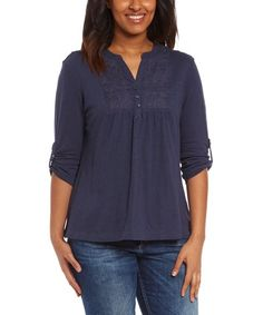 Embroidered details lend free-spirited style to this peasant top, while soft, breathable cotton ensures all-day comfort.