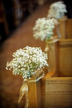 Baby's breath tied to church pews with gold ribbon. Love the smell of florals as aisle markers. {Niki Rossi Photography}