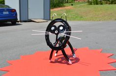 Metalley Cat. Made with Horse Shoes, Nuts, Bolts, Washers, Insulation Hangers, Part of a scroll for the tail. Powder coated in Super Mirror Black. White parts are hand painted with Rustolem metal paint.