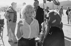American film star Marilyn Monroe (1926 - 1962) with her acting coach Paula Strasberg, the wife of 'method' teacher Lee Strasberg on the set of 'The Misfits', being filmed on location in Nevada.
