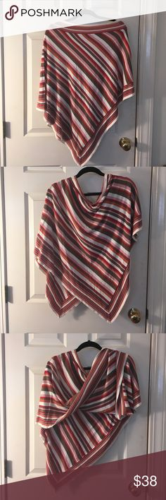Striped Triangle Poncho for All Seasons Striped Poncho Lite-Weight and Perfect for All Seasons. Colors are great and Flattering for most skin tones. Opposite striped neckline. Cut tag so it would not be seen when wearing. Boutique purchase last season but don't remember brand. Sweaters Shrugs & Ponchos