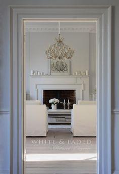 Huge chandelier in white interior