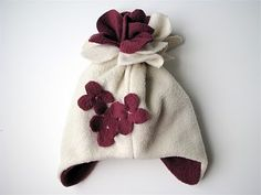Why buy Winter hats when there are so many cute fleece hat patterns to choose from, like this Snowblossom Fleece Hat? Learn how to sew a Winter hat just like this with these fleece hat directions, or customize your own with different embellishments! Fleece Crafts, Fleece Projects, Fabric Crafts, Sewing Crafts, Sewing Projects, Sewing For Kids, Baby Sewing, Sewing Tutorials, Sewing Patterns