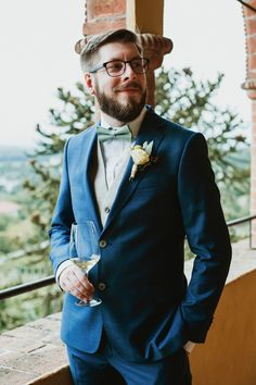 Groom in Blue Wedding Suit with Pastel Green Bowtie | By Benni Carol Photography | Italian Wedding | Italy Wedding | Pampas Grass Decor for Wedding | Outdoor Wedding | Boho Wedding | Long Sleeve Wedding Dress | Flower Crown for Bride | Wedding Suit | Groom Wedding Outfit Wedding Suits For Bride, Blue Suit Wedding, Wedding Dresses With Flowers, White Wedding Dresses, Morning Suits, Grass Decor, Groomsmen Suits, Looking Dapper, Pampas Grass