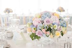 Pastel flower arrangement including hydrangeas and roses - Pastel Wedding With Ribbon Details At Hunton Park With Bride In Original Always & Forever Designed Gown And Bridesmaids In Pastel Gowns From Kelsey Rose With Groom And Groomsmen In Suits From Hugh Harris And Images By Fiona Kelly