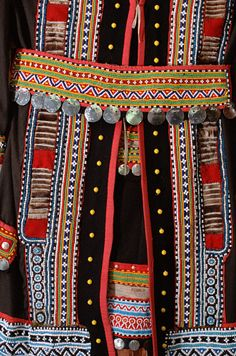 Eastern Siberia ~ Russia | A detail of a traditional Even woman's dress in the museum at Evensk. Magadan Region | © Bryan & Cherry Alexander Photography