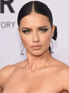 How to copy Adriana Lima's sexy smoky eye makeup and hair bow-tie (click through to see the back) from the amfAR New York Gala