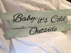 "Pallet Board Sign - ""Baby it's Cold Outside"". $25.00, via Etsy."
