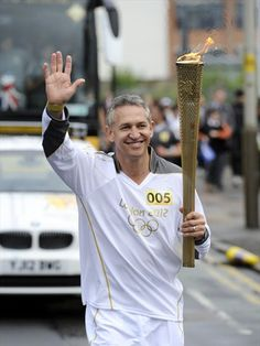 The former footballer and TV presenter carries the Flame through Leicester on Day 46 of the London 2012 Olympic Torch Relay.