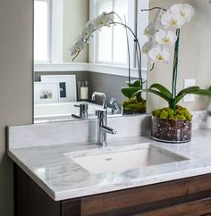 By undermounting the bathroom sink, there is ample countertop space left for toiletries and accessories