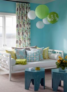 Love the idea of hanging paper lanterns in a kids room to add fun and color. They don't have to be lit, just mix and match shapes and colors.