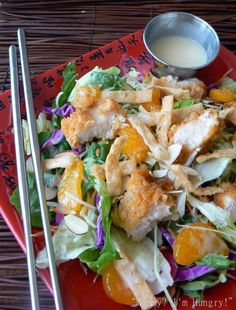 Applebee's knockoff of oriental chicken salad. Dressing: 3 Tbs honey, 1 1/2 Tbs rice vinegar, 1/4 C mayo, 1 tsp Dijon mustard & 1/8 txp sesame oil. Blend with wisk & refrigerate. Salad: 2 pieces of crispy chicken strips, bagged salad with asst lettuce & veggies, bagged broccoli slaw, 1 Tbs sliced almonds, toasted, 1/4 C fried won ton strips & 1/4 C mandarin slices, drained.