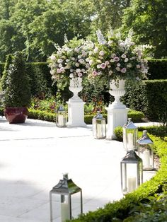 Quintessential English elegance with large floral displays and lanterns