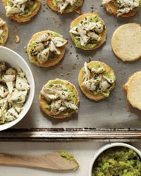 Crab-and-Avocado Toasts | This very simple and delicious starter is made by tossing sweet crabmeat with fresh mint and lime juice, then spooning it over mashed avocado on toast.