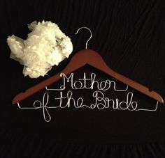 Custom Mother of the Bride and Mother of the Groom Hangers by LovieDovieShop - Get these for your entire bridal party! Adorable!