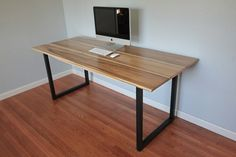 Minimalist Modern Industrial Office Desk or Dining Table // Sun Tanned Poplar // Matte Black Steel Legs. $900.00, via Etsy.