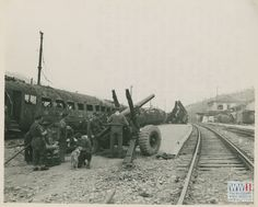 South African inch gun and crew firing from a position near a destroyed train station in Legaro, Italy, November 1944 Train Station, Ww2, World War, November, Guns, British, Army, African, Military