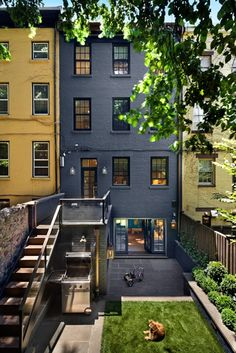 Blue townhouse with little garden