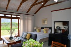 Mosaic Cottages: Milkwood Cottages Our lovely stone self-catering Mosaic Cottages, on the Hermanus Lagoon, are surrounded by milkwood trees and fynbos gardens, and perfect for families to enjoy plenty of space, activities and time together. Each has a unique layout and occupancy ranges from a cottage sleeping 9 guests (Duminy Cottage), to the smallest sleeping … Small, Room Divider, Furniture, Interior, Mosaic, Bedroom, Home Decor, Cottage