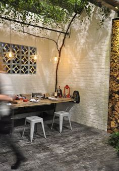 With old bricks, wire pendent lights, huge metal beams and rusted pipes lashed together to make the enclosed courtyard, it is a modern industrial take on a natural outdoor space.: