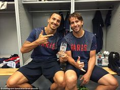 Zlatan Ibrahimovic (left) poses with his MVP award next to defender Maxwell following PSG'...