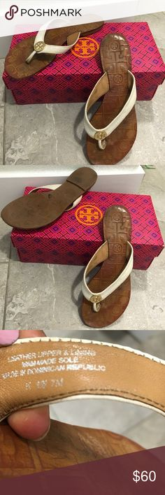 Authentic Tory BURCH Thora white slippers These are a unique pair of comfortable slipper by Tory BURCH thing type slippers with T emblem on front in gold. They are all leather. They have a lot of wear left.. They are size 7 Tory Burch Shoes Slippers